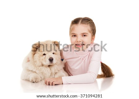 Little girl with chow-chow puppie  - stock photo