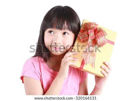 Little girl with christmas gift - stock photo