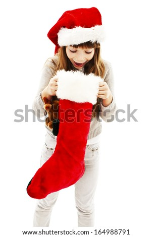 Little girl with Christmas gift. Isolated on white background.