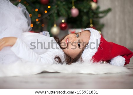 Little girl with christmas hat - stock photo