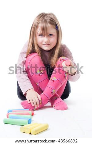 LIttle girl with color chalks look at camera