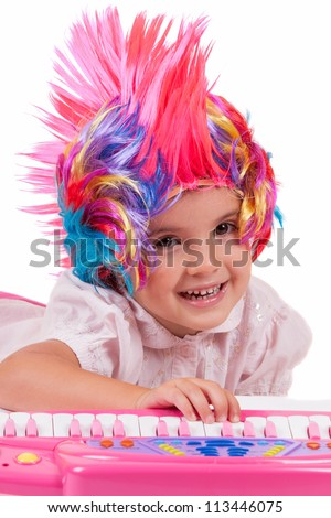 Little girl with colorful wigs - stock photo