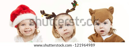 little girl with costumes of Santa, deer and bear - stock photo
