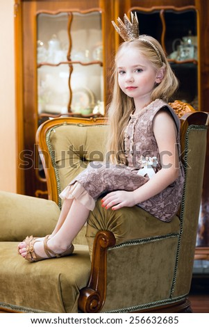 Little girl with crown - stock photo