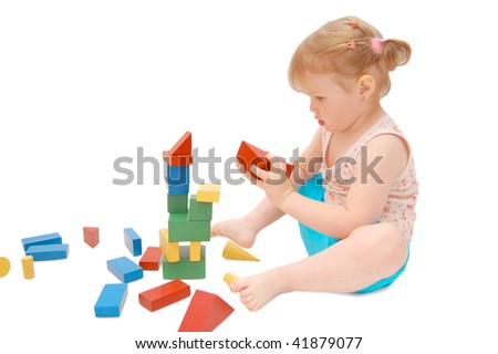 Little girl with cubes  isolated on white