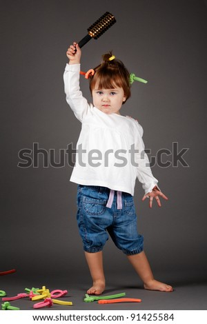 little girl with curlers and brush - stock photo