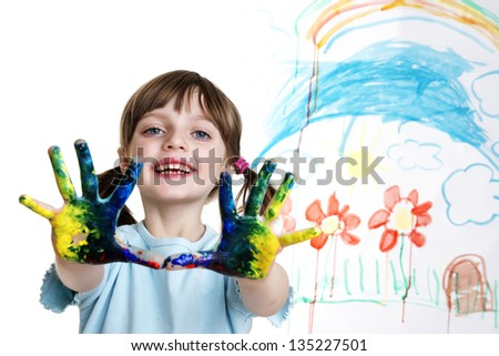 little girl with dirty hands painting her happy picture - stock photo