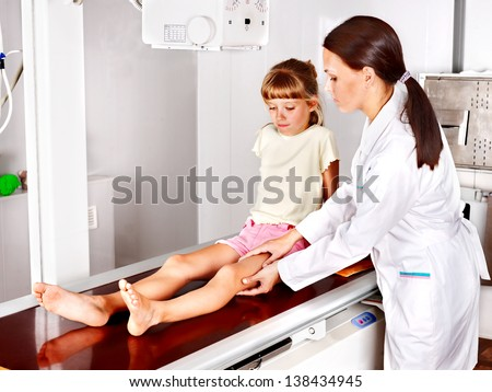 Little girl with doctor radiologist. - stock photo