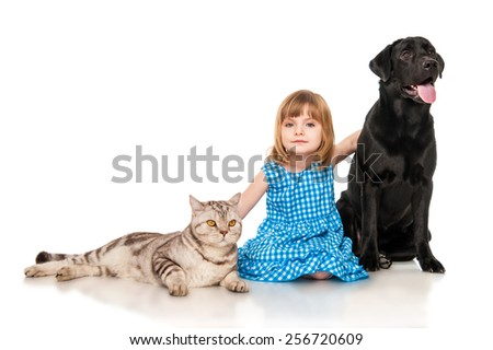 Little girl with dog and cat - stock photo