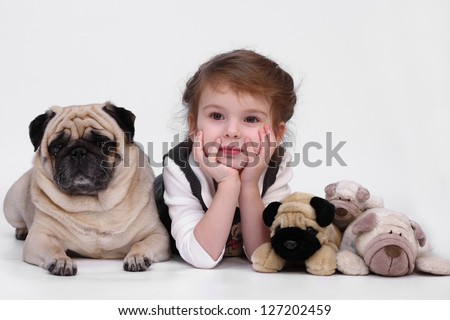 Little girl with dog breed pug on a white background - stock photo