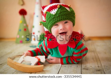 Little girl with Down syndrome laughs heartily - stock photo