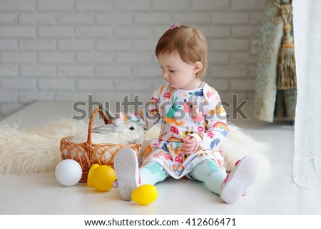 little girl with Easter basket and Easter bunny