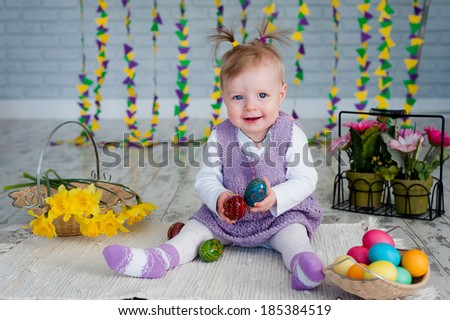 Little girl with easter eggs yellow flowers Narcissus