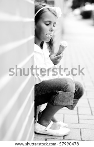 little girl with eis - stock photo