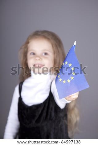 Little girl with european union flag. Studio shot. - stock photo