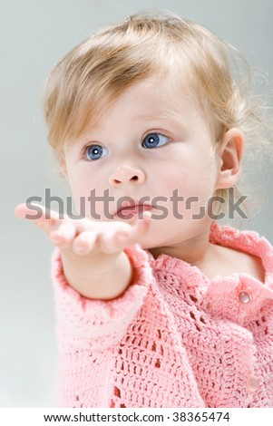 Little girl with extended hand - stock photo