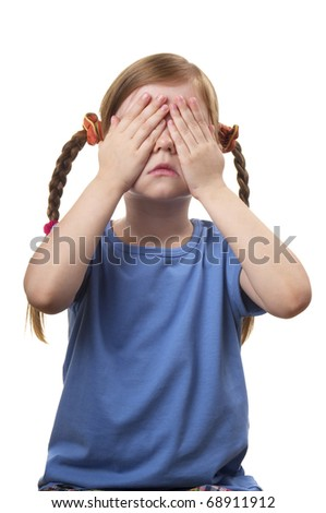 Little girl with eyes closed by her hands isolated over white background - stock photo