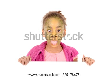 little girl with face painted as a lizard isolated in white