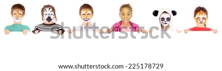 little girl with face painted as a zebra isolated in white - stock photo