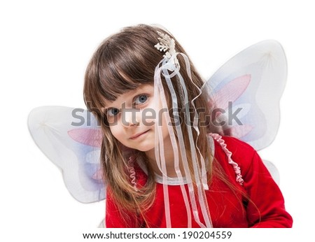 Little girl with fairy wings and wand - stock photo