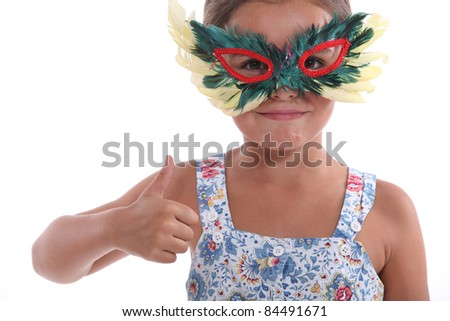 Little girl with feather mask - stock photo