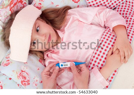 Little girl with fever in the bed - stock photo