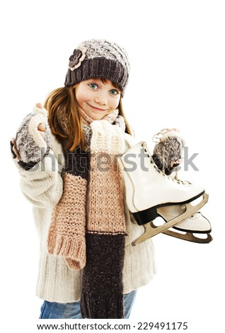 Little girl with figure skates, showing OK sign. Isolated on white background  - stock photo
