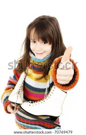 Little girl with figure skates, showing OK sign. Studio shoot - stock photo