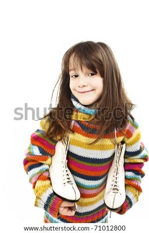 Little girl with figure skates. Studio shoot - stock photo