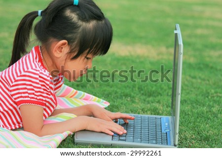 little girl with fingers on laptop - stock photo