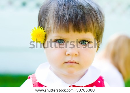 little girl with flower portrait - stock photo