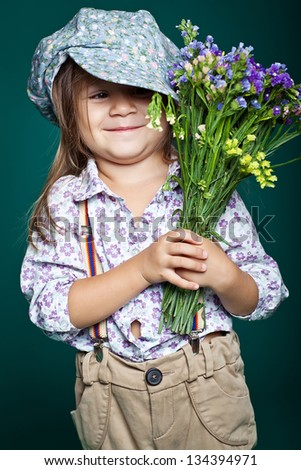 Little girl with flowers. Isolated.