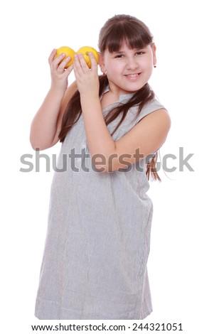 little girl with fresh yellow lemons - stock photo