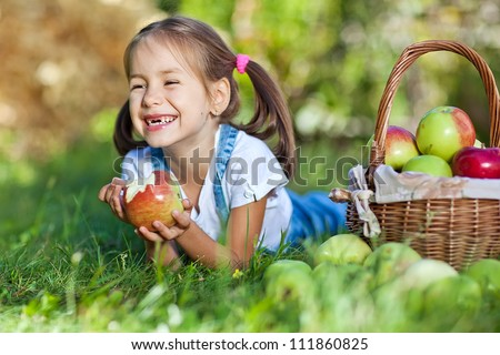 Little girl with fruit.