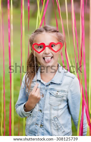 little girl with funny paper glasses - stock photo