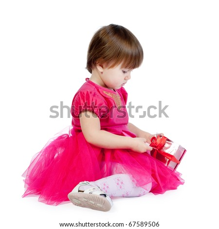 little girl with gift - stock photo
