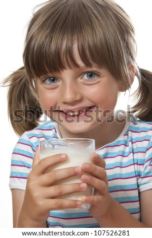 little girl with glass of milk - stock photo