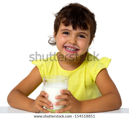 little girl with glass of milk isolated on white - stock photo
