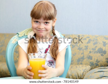 little girl with glass of orange juice