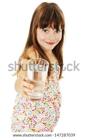 Little girl with glass of water. Isolated on white background - stock photo