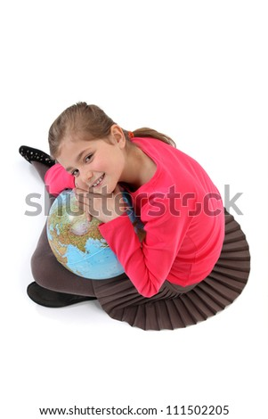 Little girl with globe - stock photo
