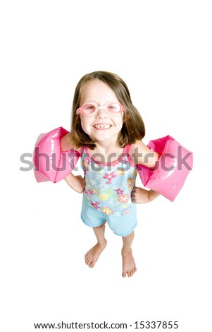 little girl with goggles and water wings, wide angle above view shot