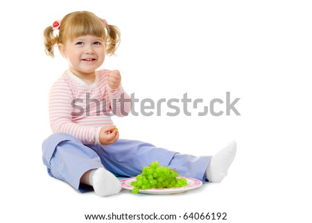 Little girl with grapes isolated - stock photo