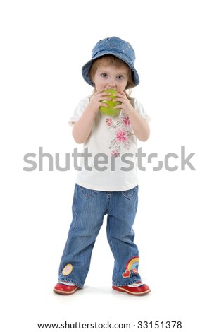 Little girl with green apple isolated on white background - stock photo