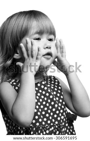 Little girl with hands close to face isolated on white background - stock photo