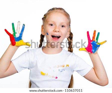 little girl with �¢??�¢??hands in paint on a white background - stock photo