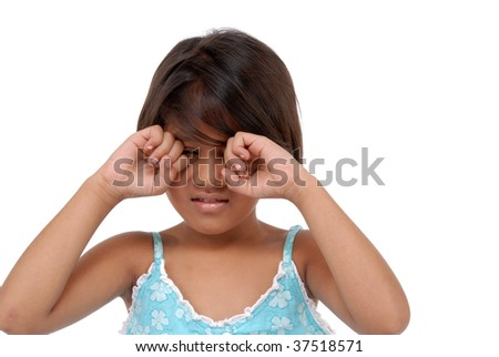 little girl with hands on eyes