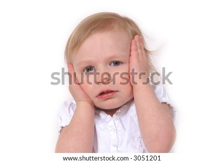 Little girl with hands on face, looking frustrated - stock photo