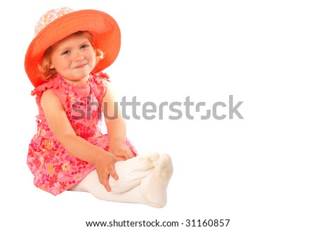 Little Girl with Hat Sitting down - stock photo