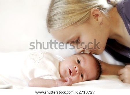 Little girl with her baby brother - stock photo